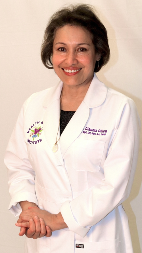 Female doctor posing in white lab coat